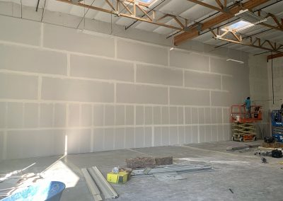 Ruby Bloom Boutique warehouse framing and drywall